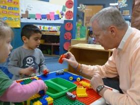 Bill Bravener playing with children