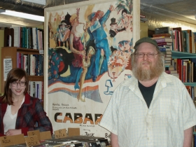 A recent acquisition of a Cabaret poster from its days on Broadway lights up Bay View Books & Music, along with Phie Troka and Dan Dehling.