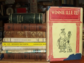 """Winnie Ille Pu,"" a Latin version of ""Winnie the Pooh,"" awaits a lucky buyer at Bay View Books & Music. Photo by Peggy Schulz."