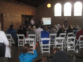 Neighborhood residents listen to the presentation.