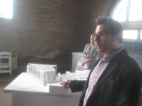 Joel Agacki points to the Model of 2202 S. Kinnickinnic Ave.