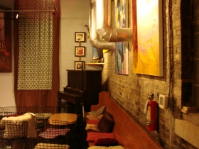 The back room where music plays and events are held.