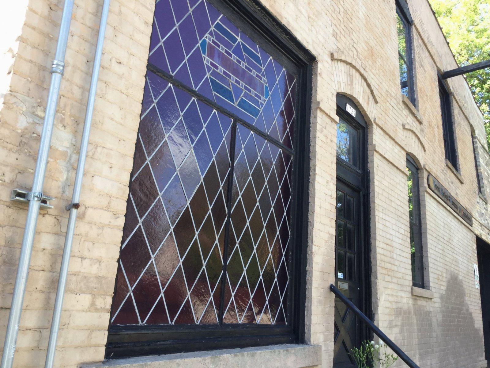 Leaded glass window on Pulaski St.