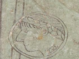 Coin design on the sidewalk.