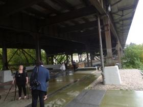 Preparing to take wedding photos under the Marsupial Bridge.