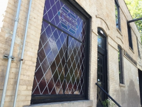 Leaded glass window on Pulaski St.