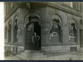 Old picture of a man standing in front of Pabst saloon.