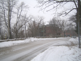 The Dixon Duplex as seen from the northeast on a snowy afternoon. It lies on one of the high points of Brewers' Hill.  The former