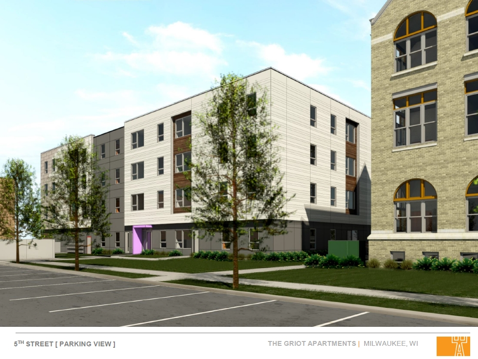 Griot Apartments - 5th Street Parking View