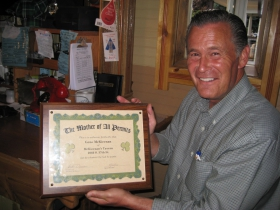 """Ald. Donovan displays the """"The Mother of All Permits."""" Photo by Michael Horne."""