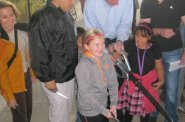 Kristen Bennet, Ald. Jose Perez, Mayor Tom Barret, and Ald. Tony Zielinski with help from some children cut the ribbon.