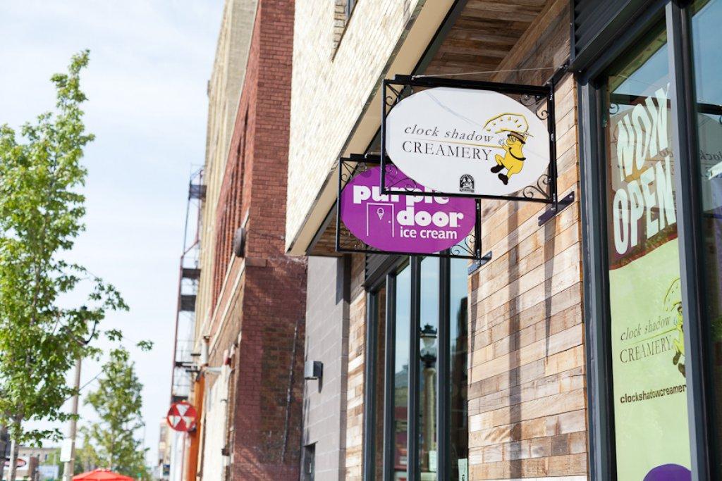 Clock Shadow Creamery and Purple Door Sign