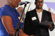 Melissa Goins, Maures Development Group, (ACRE Alumni) with Joaquin Altoro, Town Bank (ACRE Alumni) in background.