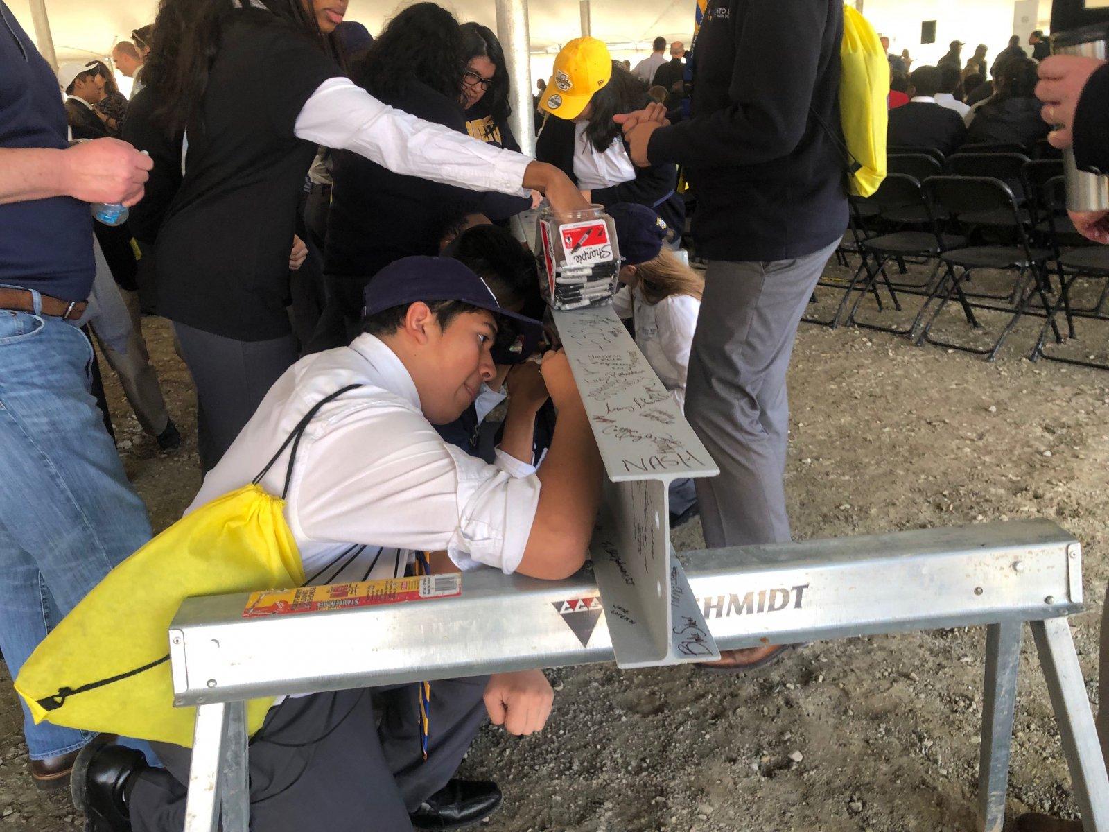 Cristo Rey Students Signing Steel Beams