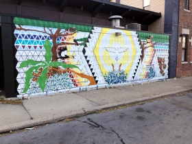 Mural on the side of Love's On Tap, 201 W. Mitchell St.