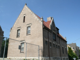 Carriage House at 3030 W. Highland Blvd.