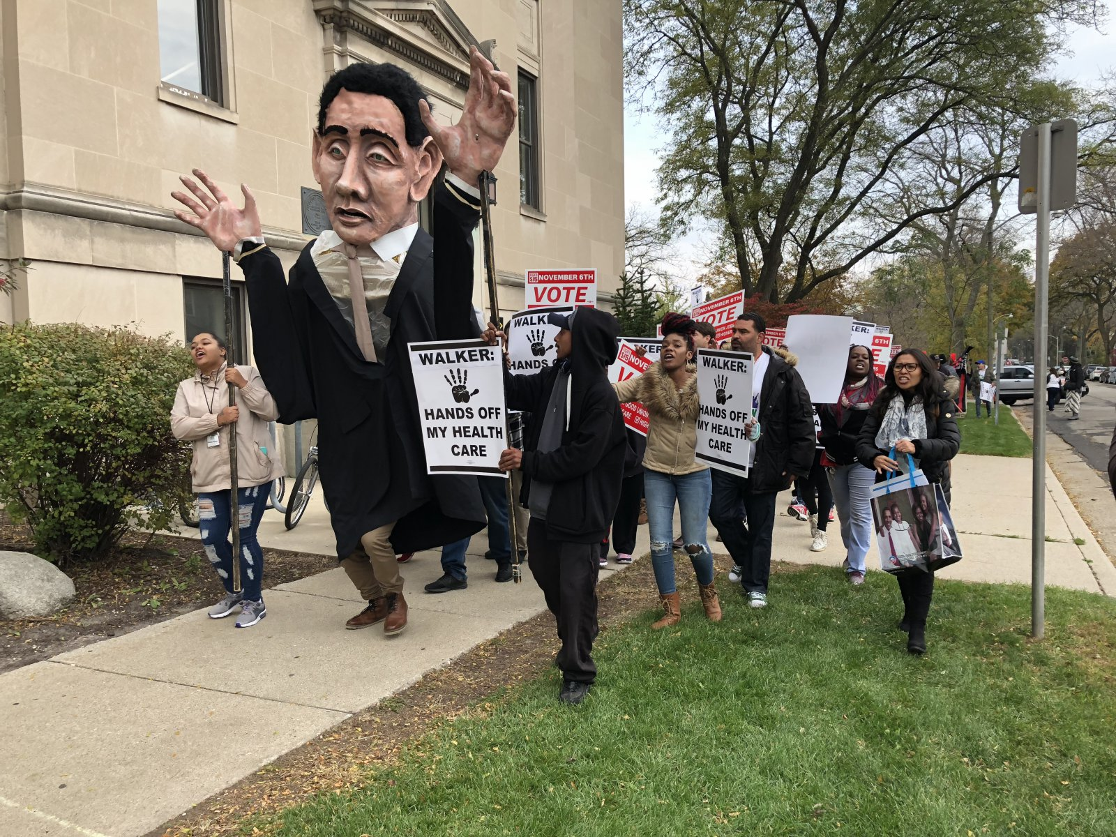 Protesters marched around the University of Wisconsin-Milwaukee\'s Helene Zelazo Center.