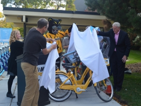 UWM chief sustainability officer Kate M. Nelson, Bublr Bikes executive director Kevin Hardman and Mayor Tom Barrett