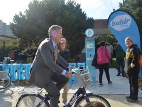 UWM Chancellor Mark Mone on a Bublr bike