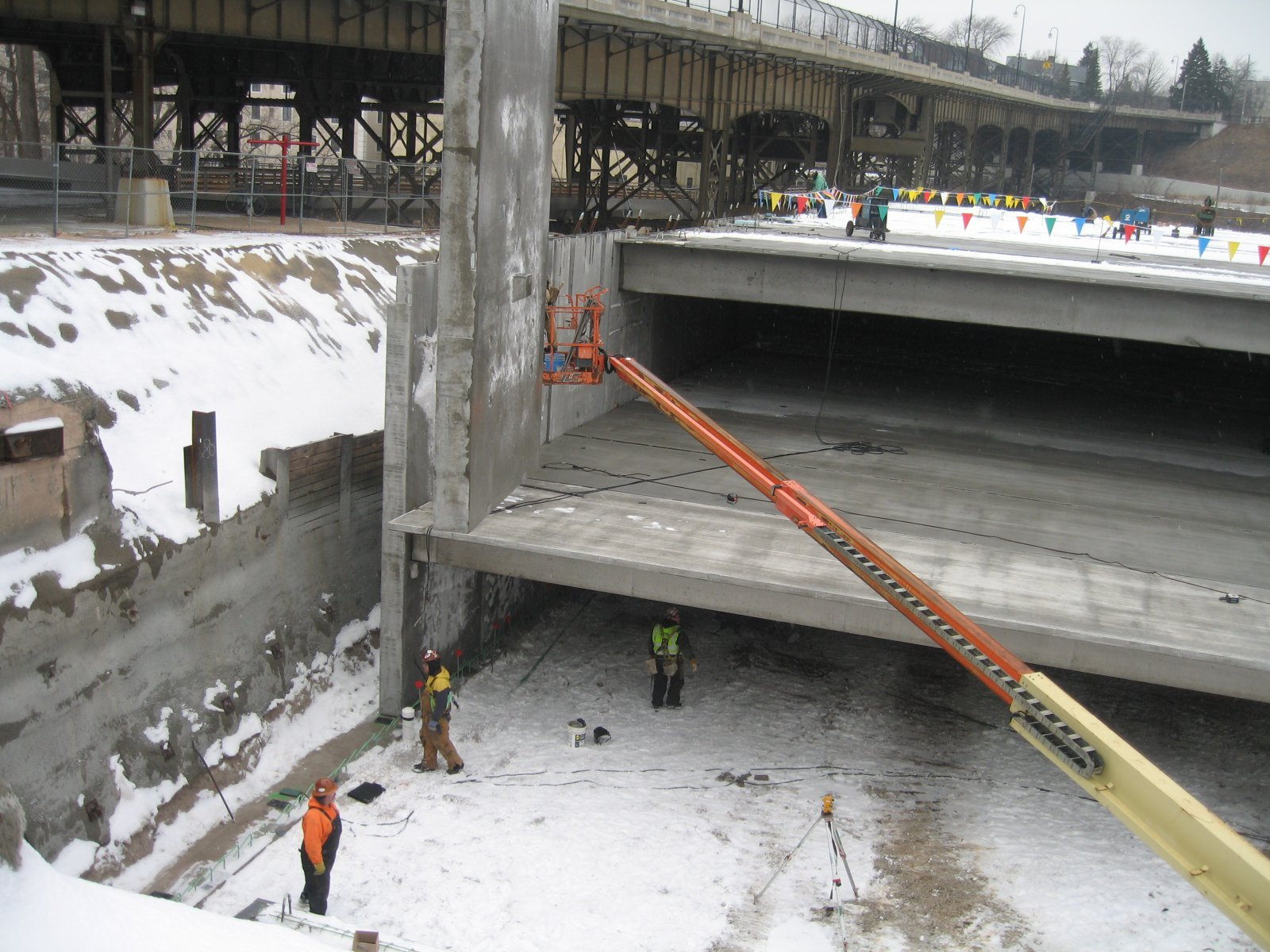 Precast concrete panel being lifted into place