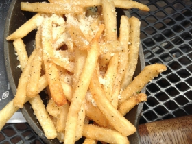 Shoestring fries served in a cast-iron dish