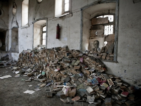 Soviet era books are collected to trash in a former library in Quba. The alphabet in the country was changed from Cyrillic to Turkish after the independence and history of the country is now being re-writen, thus most of Soviet books became not needed. Azerbaijan. 2011