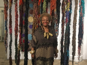 Rosemary Ollison: The artist in front of some of her leather works