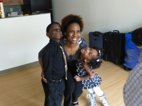 Mercia Harris-Williams and her children celebrate having a place to call home. Photo by Brett Kihlmire.
