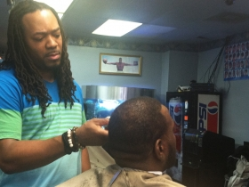 Getting a haircut at Style's Superior Barber Shop. Photo by Tony Atkins.