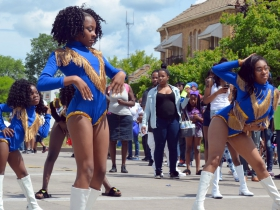 A dance group strikes a pose