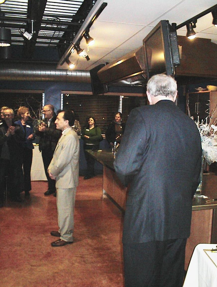 The mayor looks on as Ed Fallone addresses the crowd at his fundraiser.