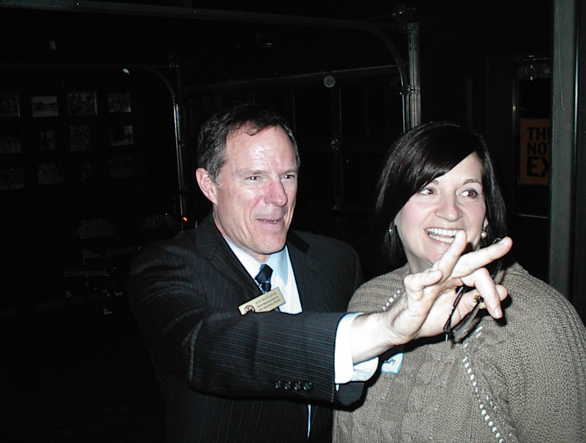 An unusually animated Rep. Jon Richards gestures at his fundraiser.