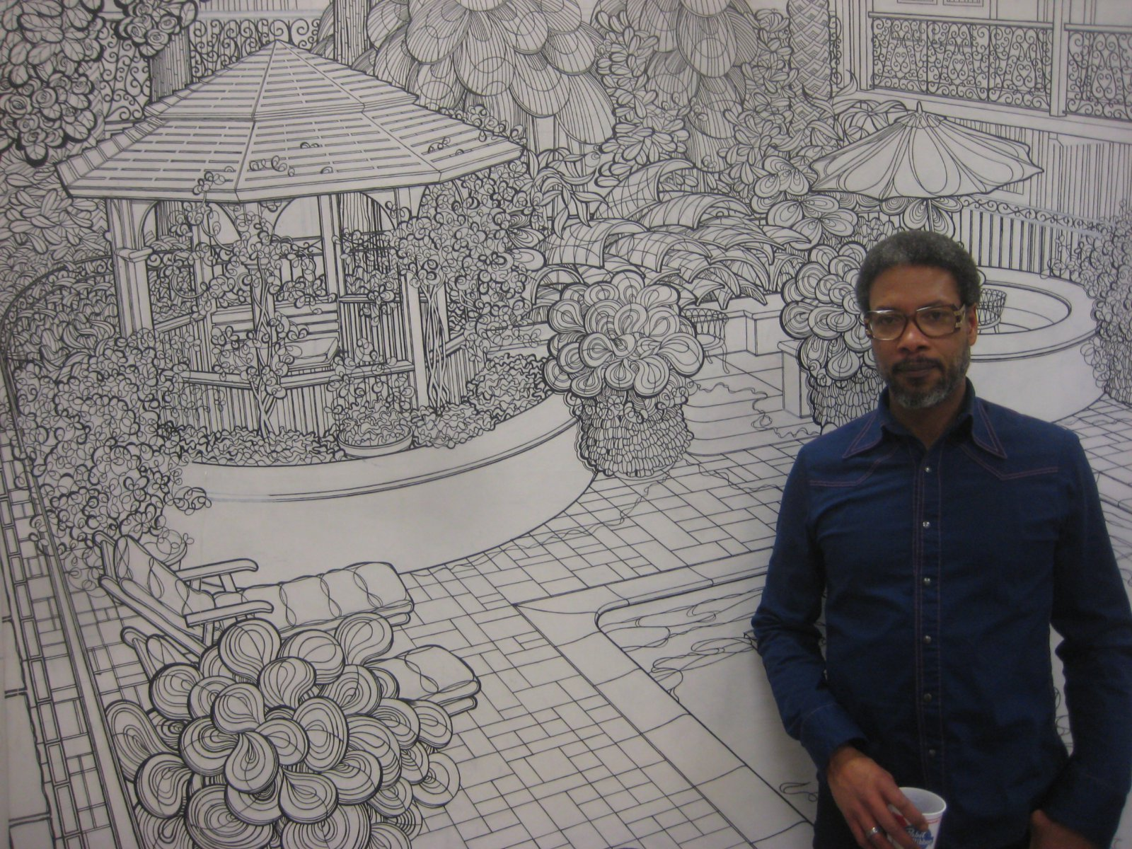 Reggie Baylor in front of his largest and most intricate composition.