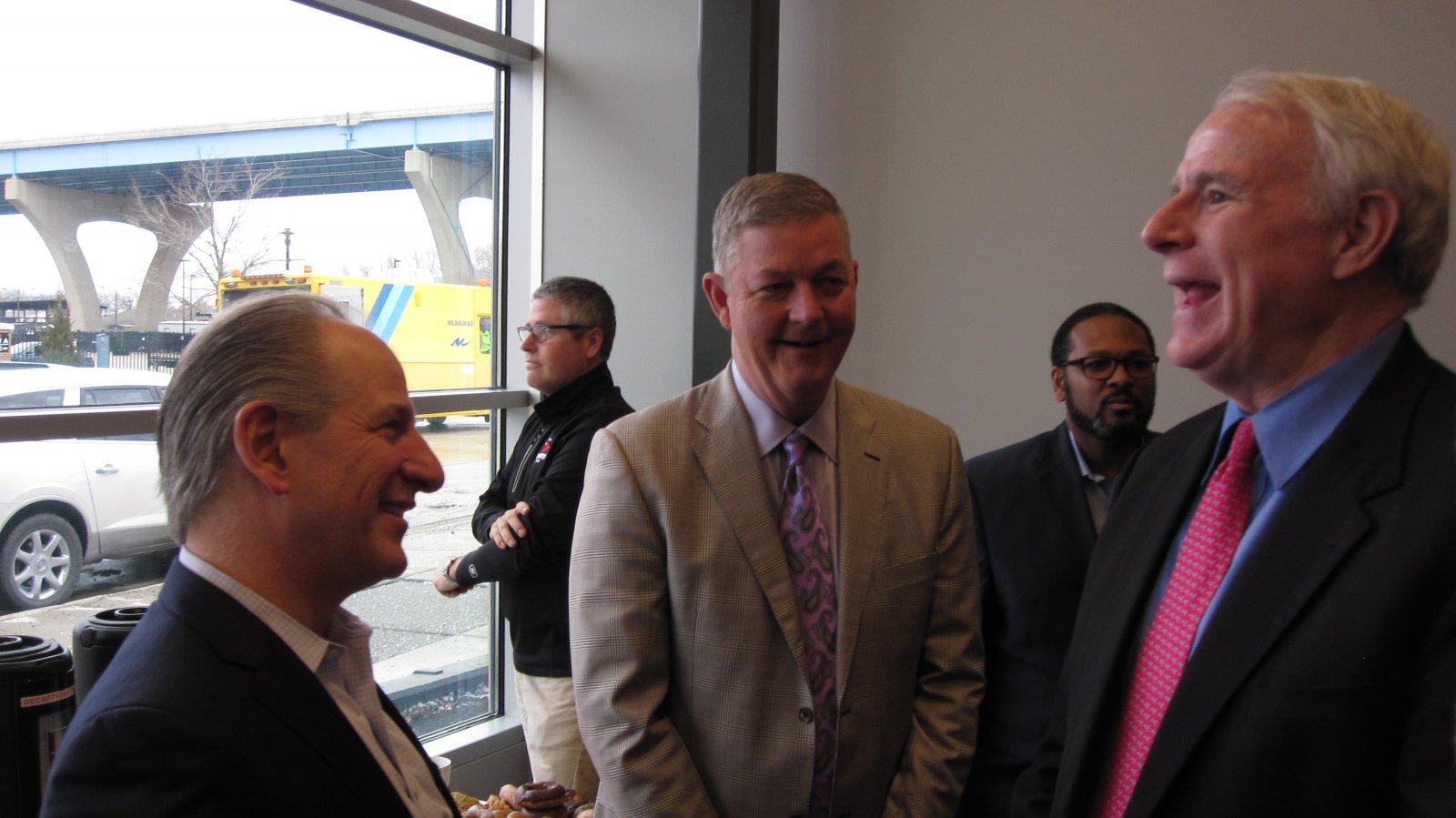 Greg Marcus, Tim Sheehy and Tom Barrett. Ashanti Hamilton in the background.