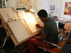 Reginald Baylor Working on a Painting