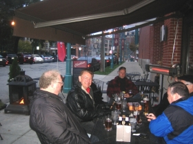 Jim Wiechmann and his real estate buddies gather on a Saturday afternoon outside Charlie's to drink and smoke cigars.