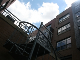 Staircase to courtyard at Gaslight Lofts.