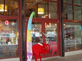 Floor-to-ceiling windows offer passersby a view of the delicacies inside Red Elephant Chocolate. Photo by Peggy Schulz.