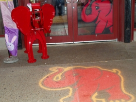 """""""Cocoa,"""" Red Elephant's mascot, is seen in solid and projected form at the cafe entrance. Photo by Peggy Schulz."""