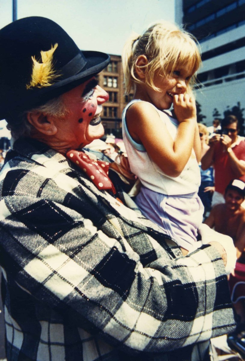 Ernest Borgnine as a clown with a child at the Circus Parade, late 1990s
