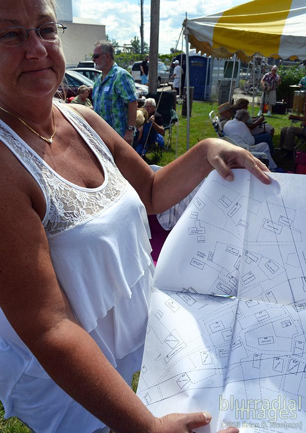 Sharon Sanders (nee Bialk) shows off a map from her deep folder of Jones Island history.