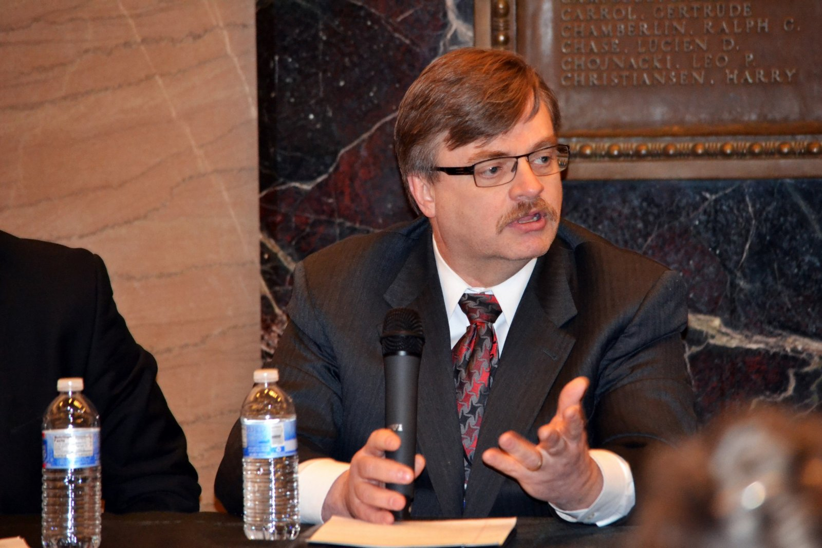 Commissioner Dahlberg explained how DNS stabilizes Milwaukee\'s foreclosed properties with board up practices.