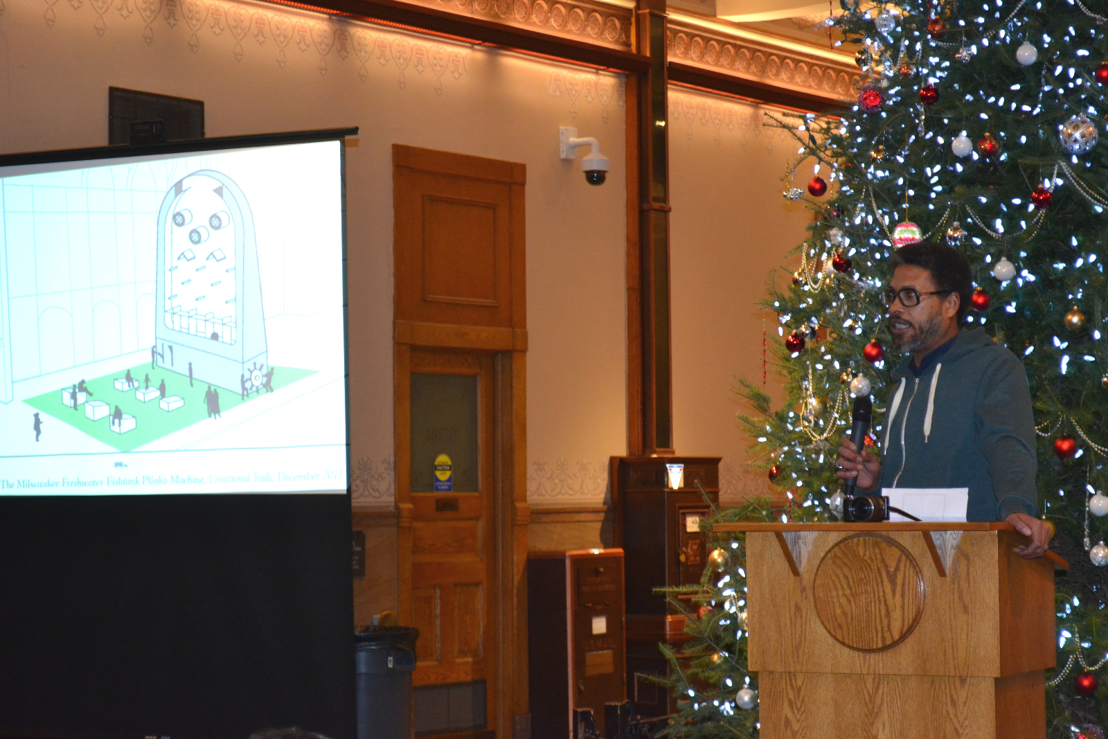 Milwaukee artist Reginald Baylor proposes building an oversize plinko-esque arcade game along the Avenue. The artist explained that he enjoys making references to childhood.