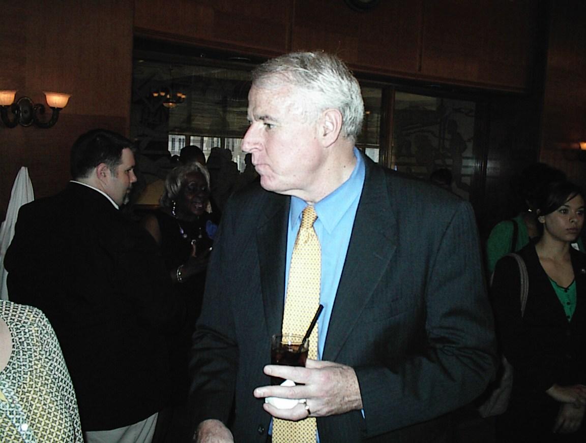 Mayor Barrett looks around at the Gwen Moore birthday party.