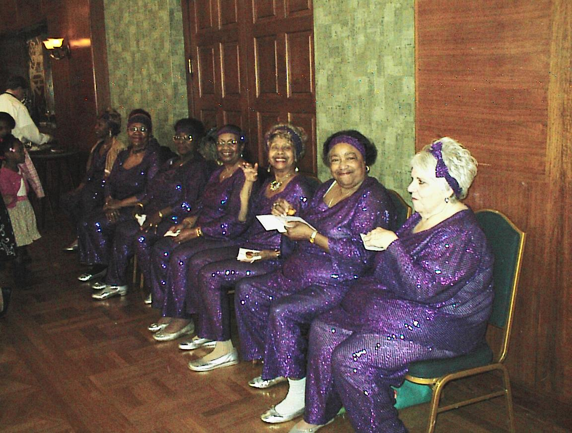 These women in purple are getting ready to put on a show for their Congressman, Gwen Moore.