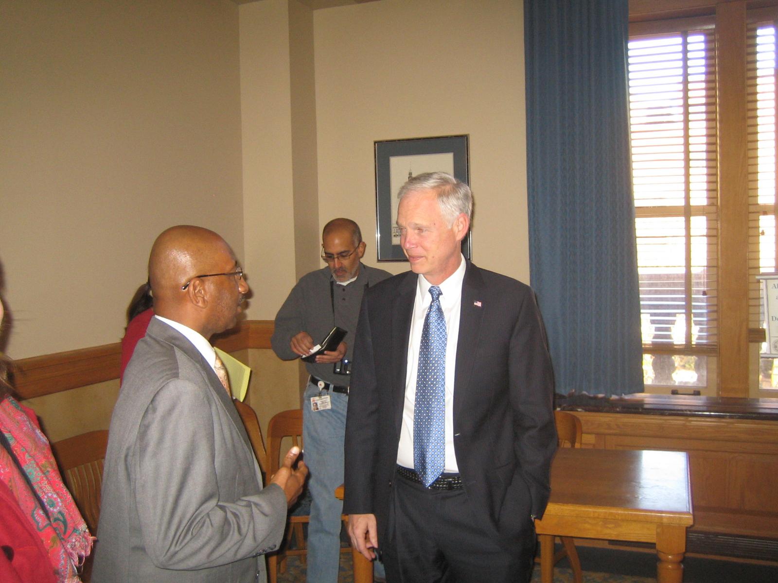 Ald. Joe Davis chats with US Sen. Ron Johnson.