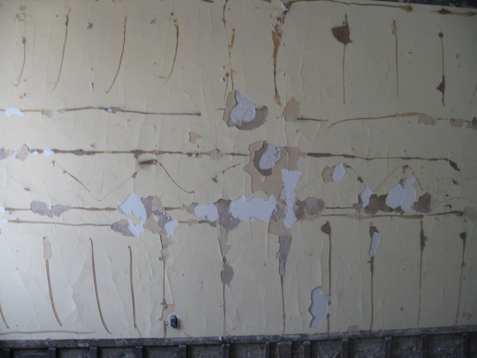 Old plaster walls show years of painting and repainting
