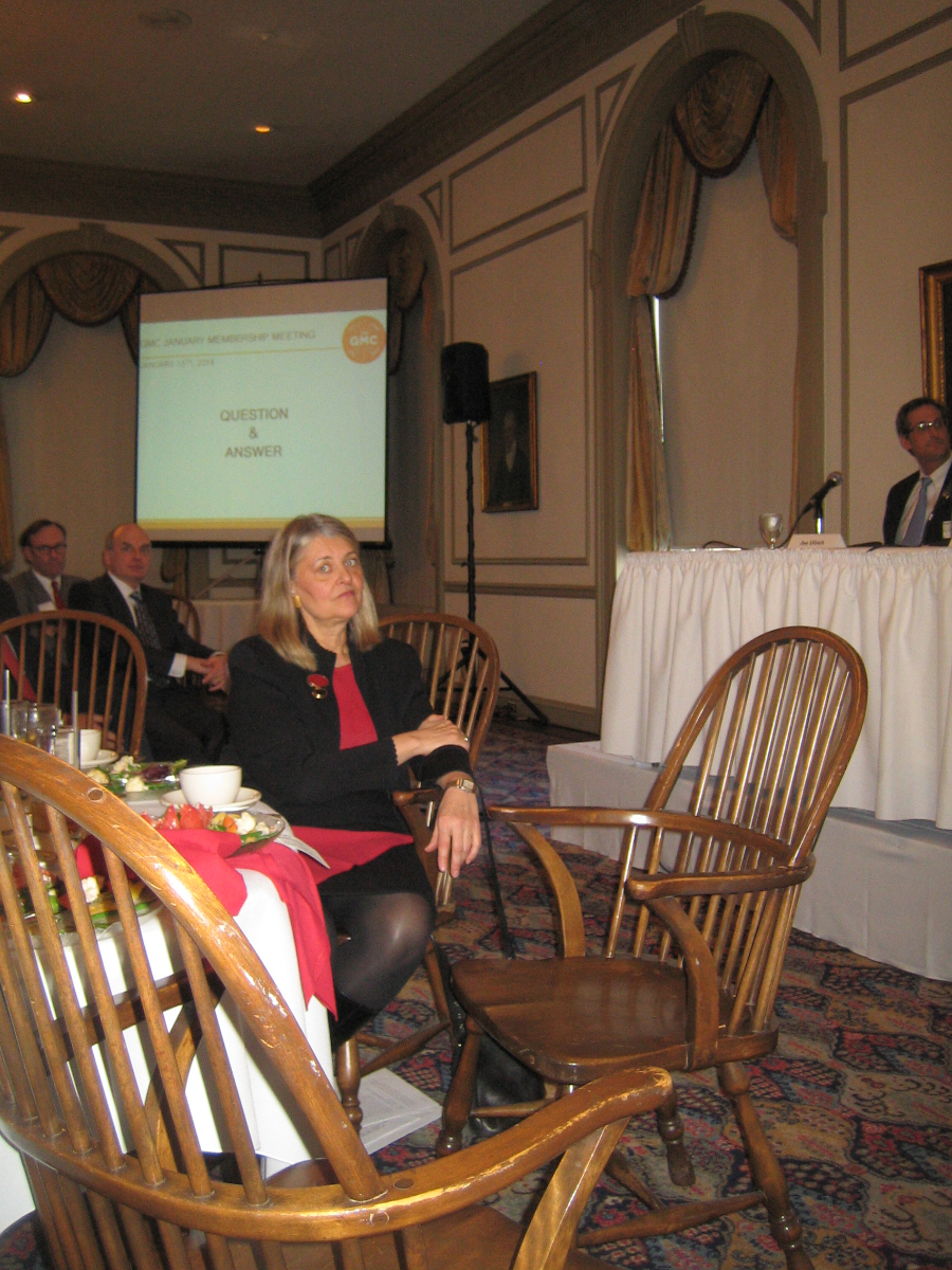 Greater Milwaukee Committee Executive Director Julia Taylor prepares for the question-and-answer round at her group\'s meeting on Downtown Development at the University Club. [Photograph taken Monday, January 13th, 2014 by Michael Horne.]