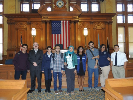 City Clerk Jim Owczarski and Milwaukee Youth Council Members pose with Egyptian students during a tour of the Common Council chamber.