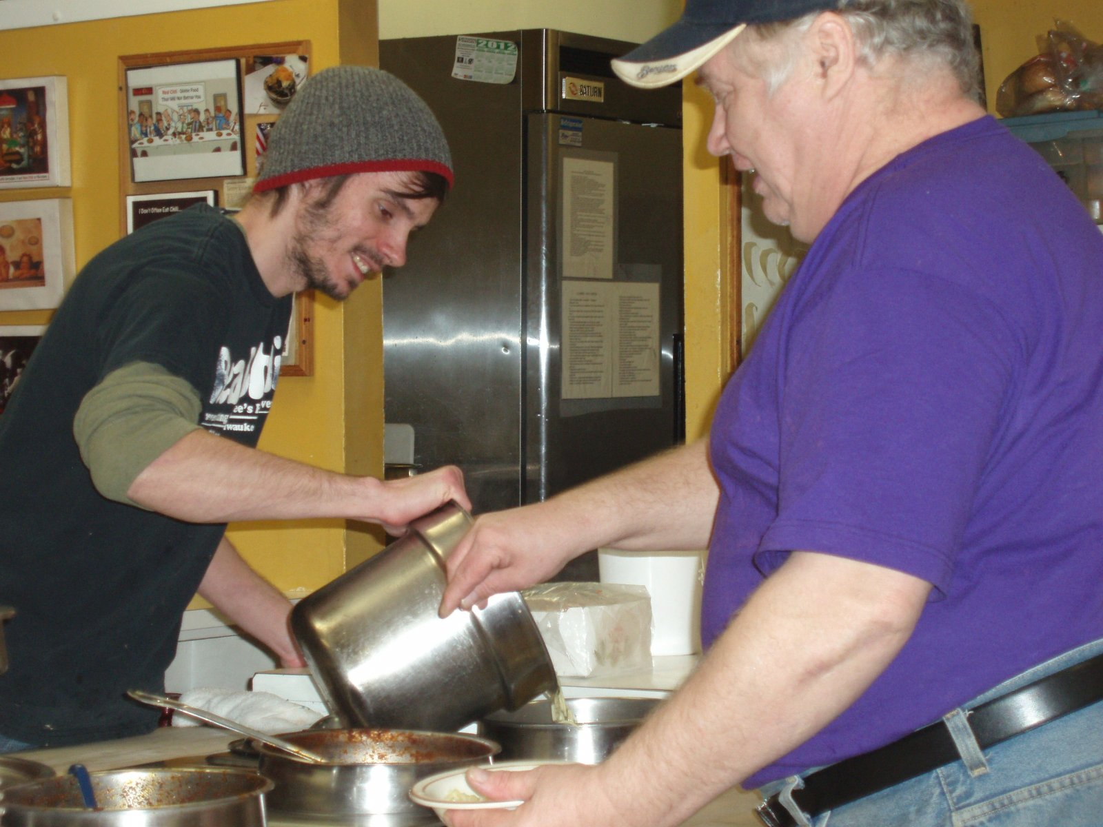 """Spanky"" and James Stocks work together at the steam table.  Photo by Peggy Schulz."